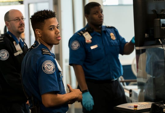 TSA agents at Burlington International Airport in South Burlington, VT, await passengers to screen at a security checkpoint on Friday, Jan. 11, 2019.