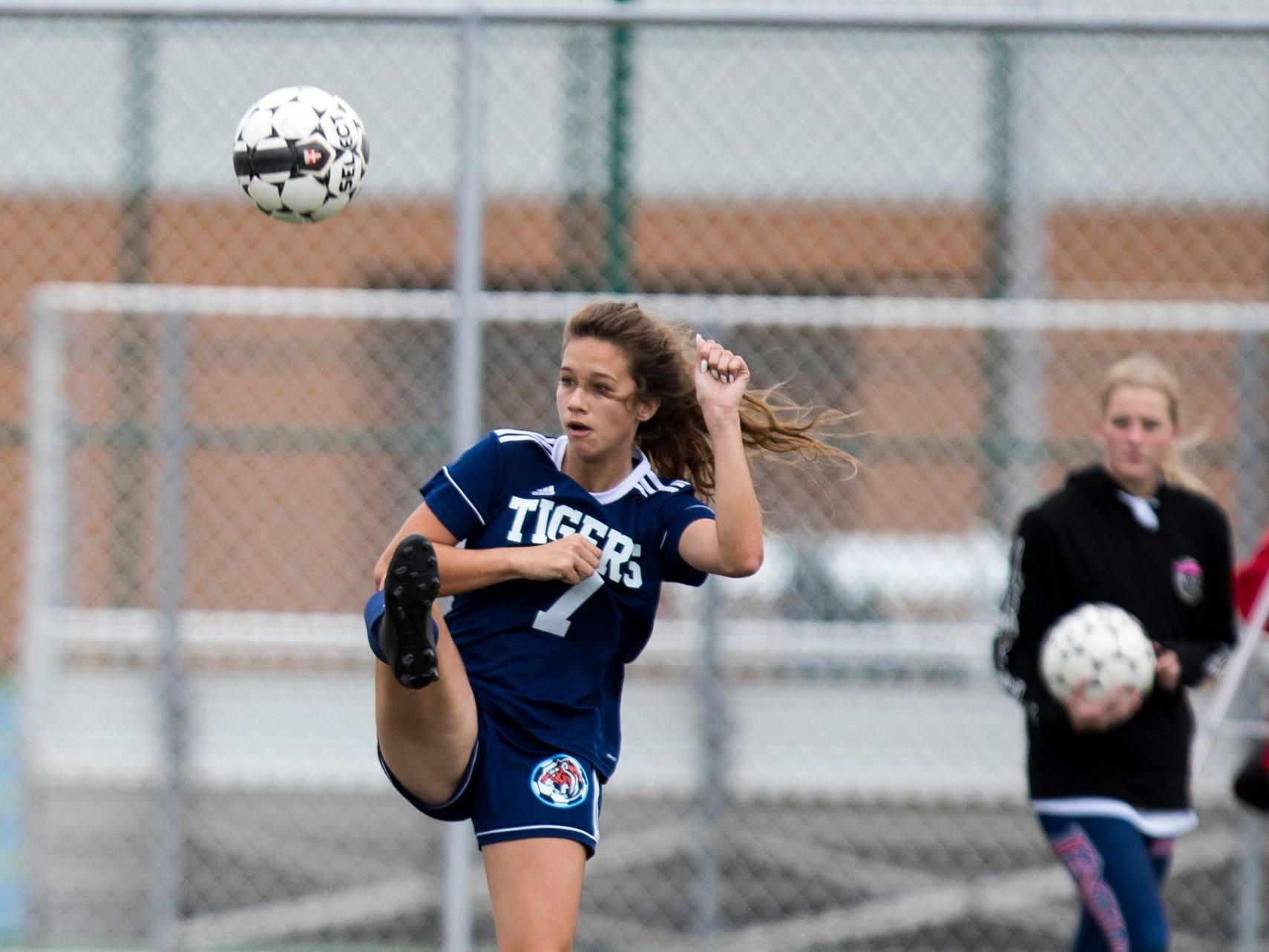 Carroll's Audrey Caster passes the ball in the game against Veterans Memorial in the Mira's Soccer Tournament at Veterans Memorial High School on Friday, January 11, 2019. The Eagles won the game 5-0.