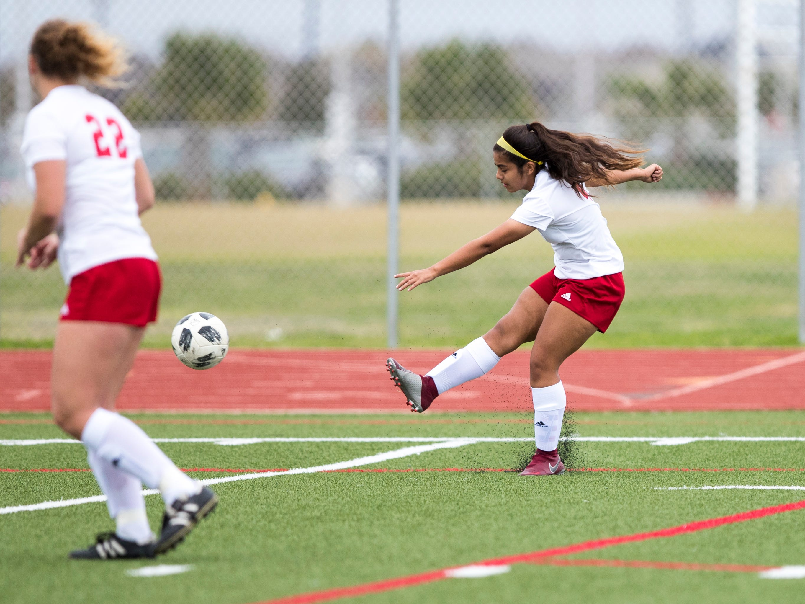 Veterans Memorial's Camryn Garcia scores in the game against Carroll in the Mira's Soccer Tournament at Veterans Memorial High School on Friday, January 11, 2019. The Eagles won the game 5-0.