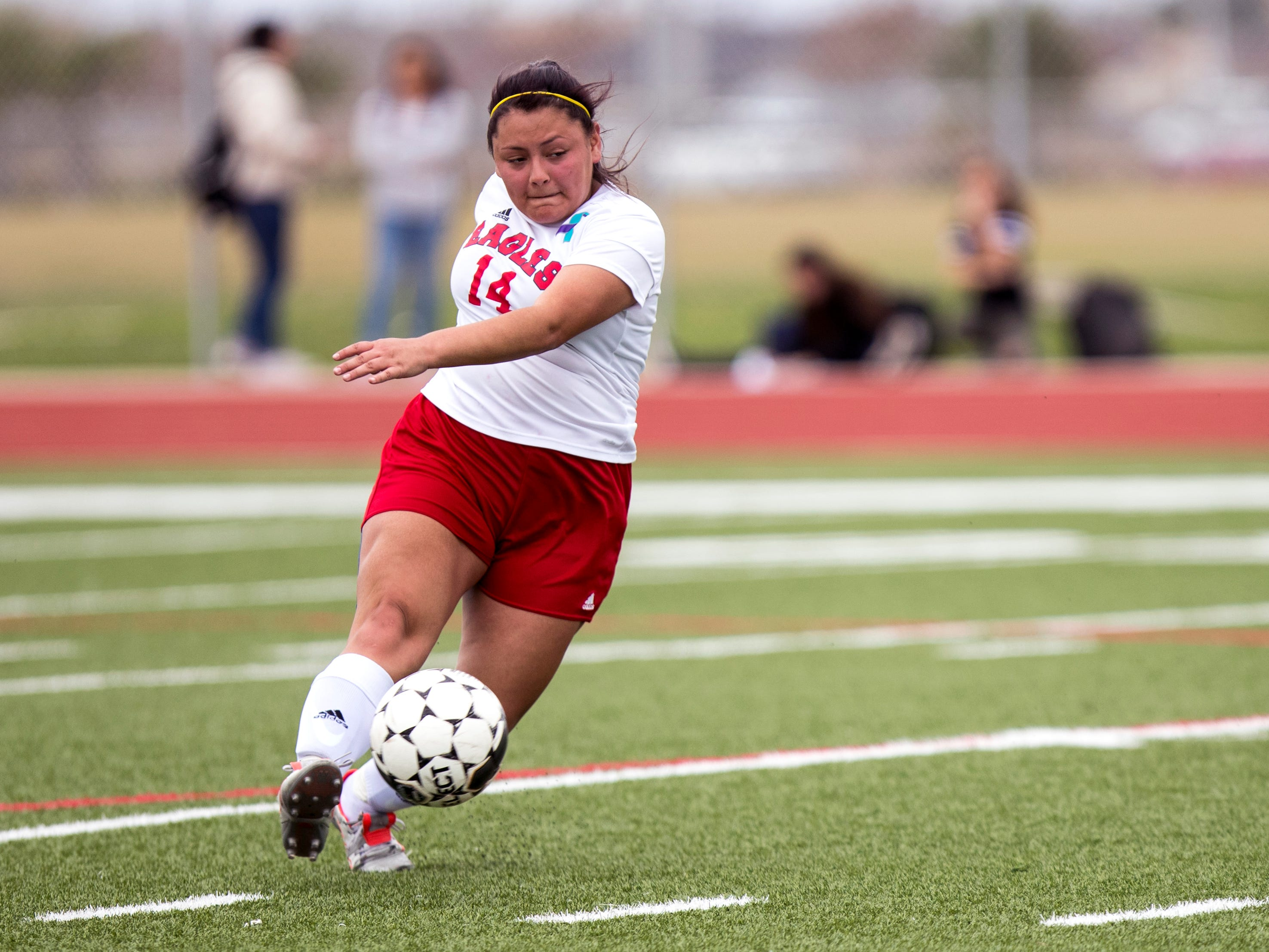 Veterans Memorial's Mauni Solis passes the ball in the game against Carroll in the Mira's Soccer Tournament at Veterans Memorial High School on Friday, January 11, 2019. The Eagles won the game 5-0.