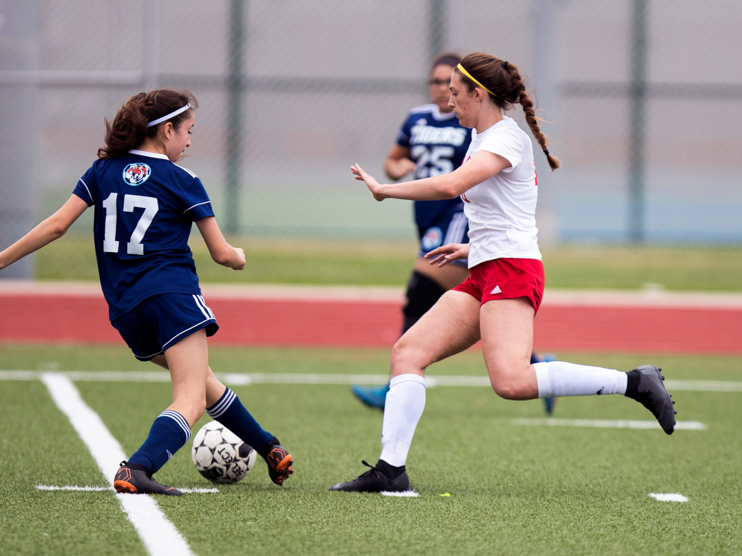 Veterans Memorial's Abigail Jones-Gittinger and Carroll's Lisa Villarreal go after the ball in the Mira's Soccer Tournament at Veterans Memorial High School on Friday, January 11, 2019. The Eagles won the game 5-0.