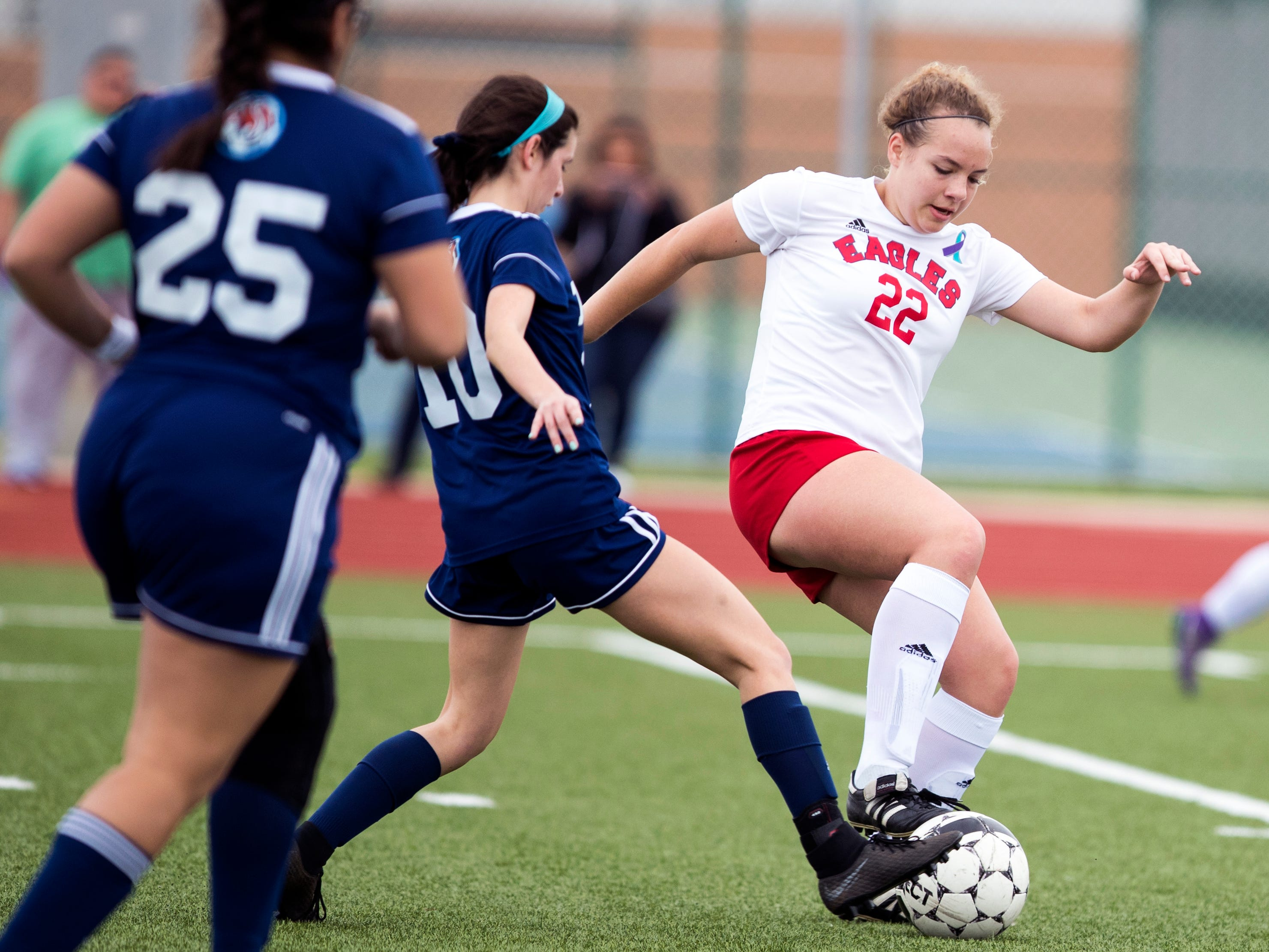 Veterans Memorial's Whitney Smith and Carroll's Emily Barrera (10) go after the ball in the Mira's Soccer Tournament at Veterans Memorial High School on Friday, January 11, 2019. The Eagles won the game 5-0.