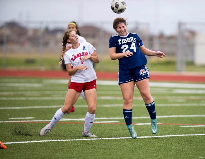 Carroll's Nicole Escamilla and Veterans Memorial's Madison Roberts go after the ball in the Mira's Soccer Tournament at Veterans Memorial High School on Friday, January 11, 2019. The Eagles won the game 5-0.