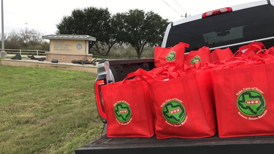 Four truckloads full of bags of food were delivered to corrections officers at the Federal Corrections Institute in Three Rivers on Friday, Jan. 11, 2019.