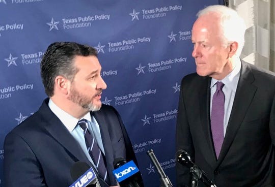 U.S. Sens. Ted Cruz, left, and John Cornyn vowed to protect disaster relief money for Hurricane Harvey from being diverted to build a border wall.