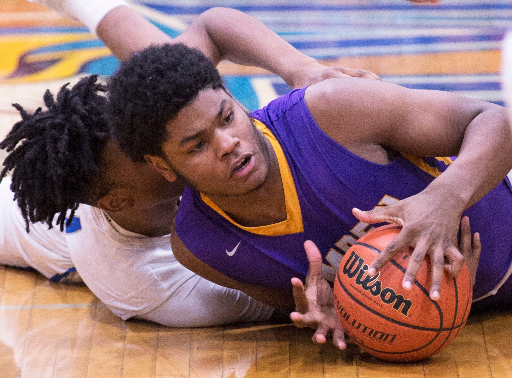 Camden's TaQuan Woodley grabs a loose ball in front of Paul VI's Hartnel Haye during the 1st quarter of the boys basketball game played at Paul VI High School in Haddon Township on Thursday, January 10, 2019.  Camden won, 63 -57.