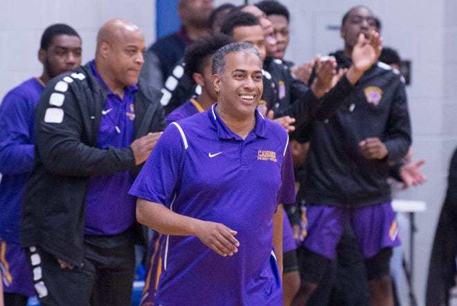 Camden High School's boys basketball coach Vic Carstarphen, center, reacts during Camden's 63 -57 victory over Paul VI, at Paul VI High School in Haddon Township on Thursday, January 10, 2019.