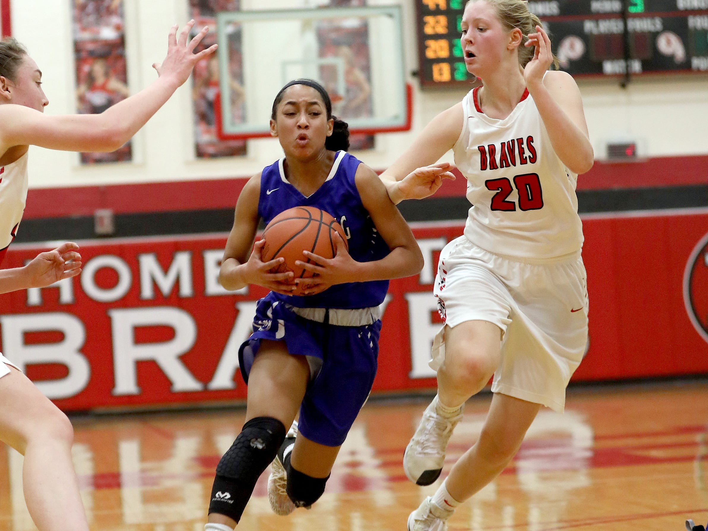 Wyoming guard Nia Kemper drives to the basket past Indian Hill guard Nina Price (20) during their basketball game , Thursday, Jan.10, 2019.