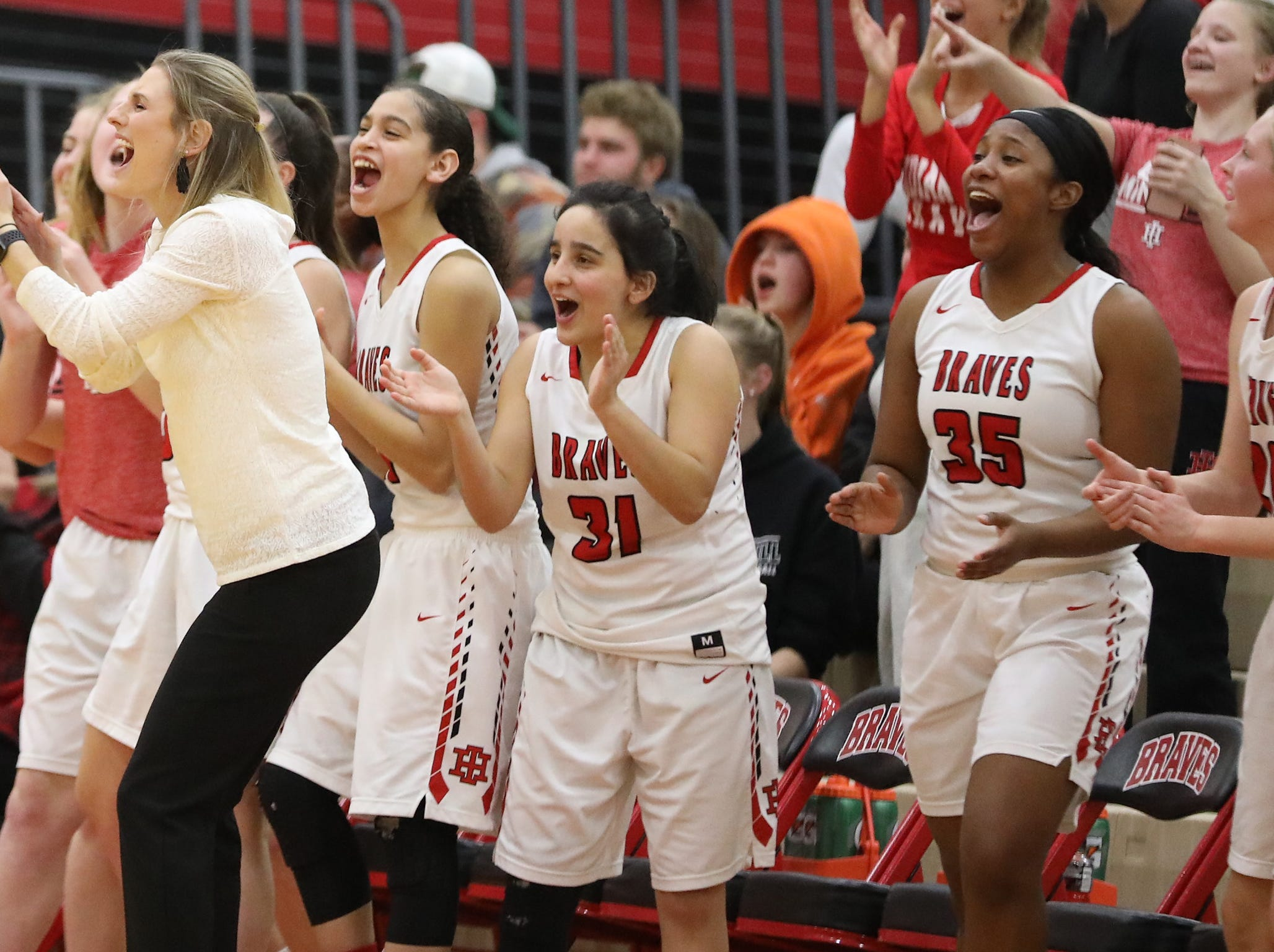 Indian Hill  bench reacts during the Braves' basketball game against Wyoming , Thursday, Jan.10, 2019.