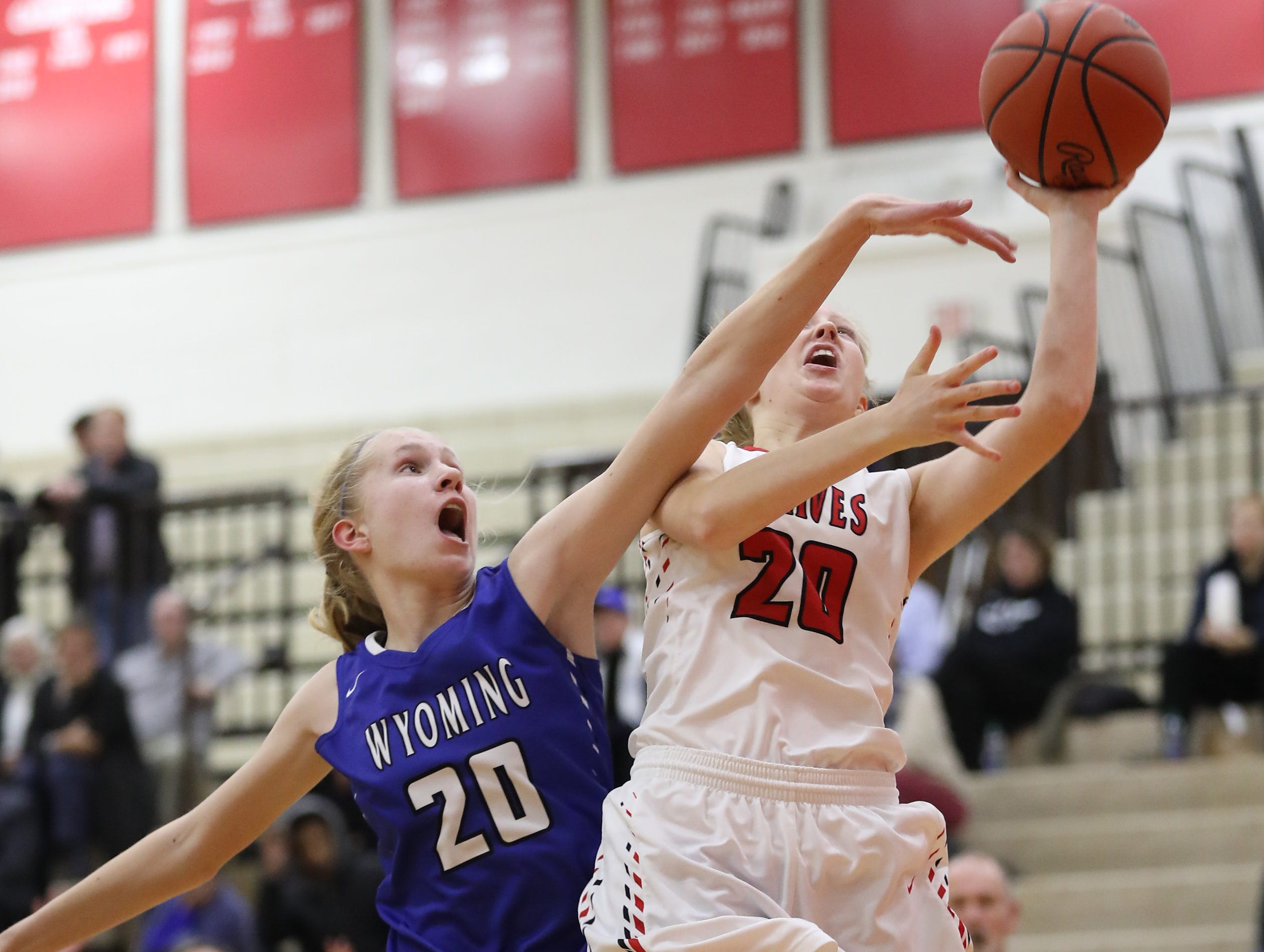 Indian Hill guard  Ella Riggs (22) drives to the basket against Wyoming guard Allison Abplanalp during their basketball game, Thursday, Jan.10,2019.