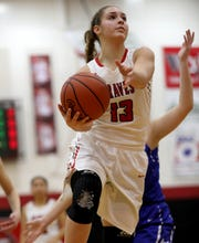 Indian Hill guard Maddie Antenucci drives to the basket during the basketball game against Wyoming, Thursday, Jan. 10,2019.
