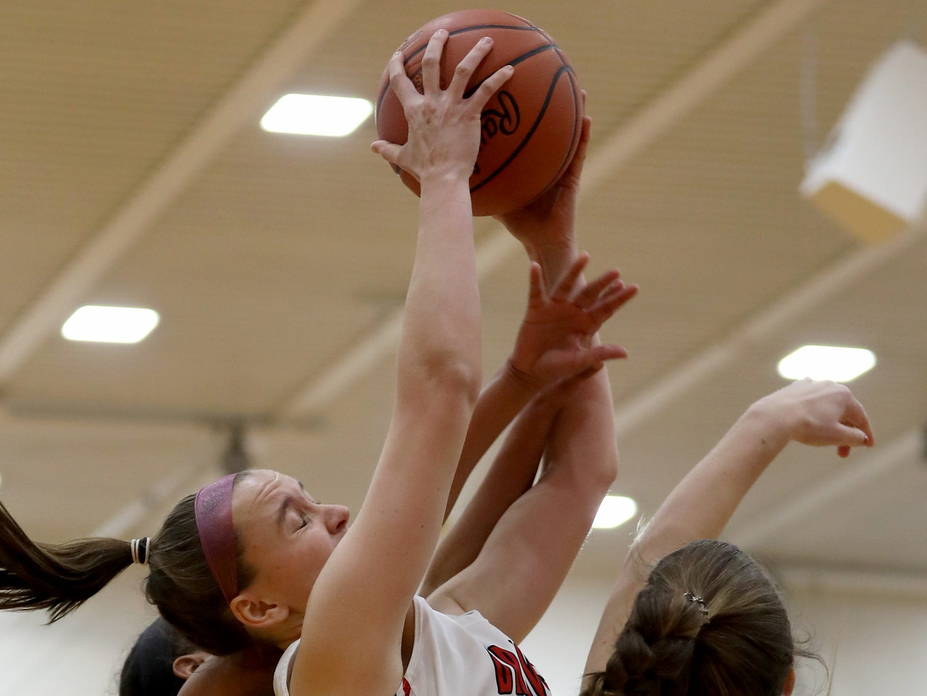 Indian HIll forward Kate Marrs (44) grabs a rebound during their basketball game against Wyoming Thursday, Jan.10, 2019.