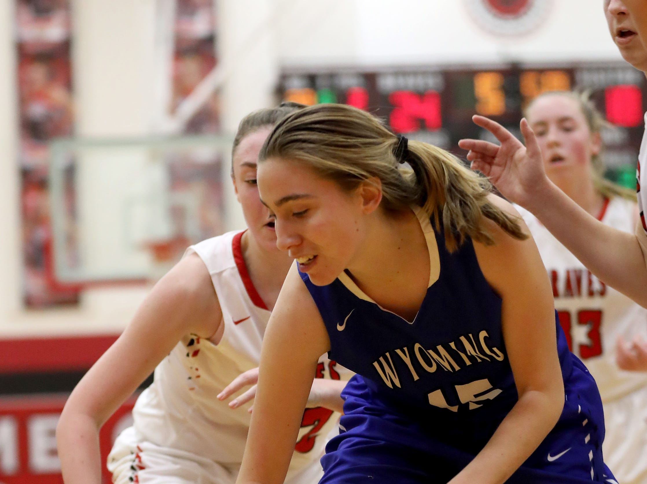 Wyoming guard Elly McCullumsmith (15) dribbles the ball  during their basketball game  against Indian Hill , Thursday, Jan.10, 2019.