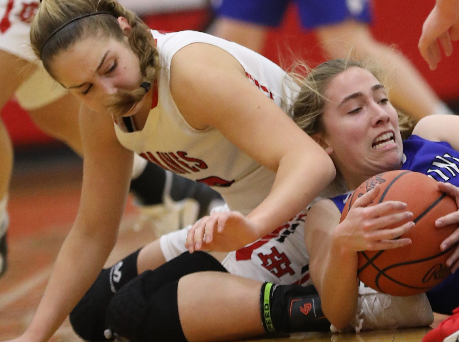 Wyoming guard Elly  McCullmsmith (15) battles Indian Hill guard Maddie Antenucci for a loose ball during their basketball game Thursday, Jan. 10,2019.