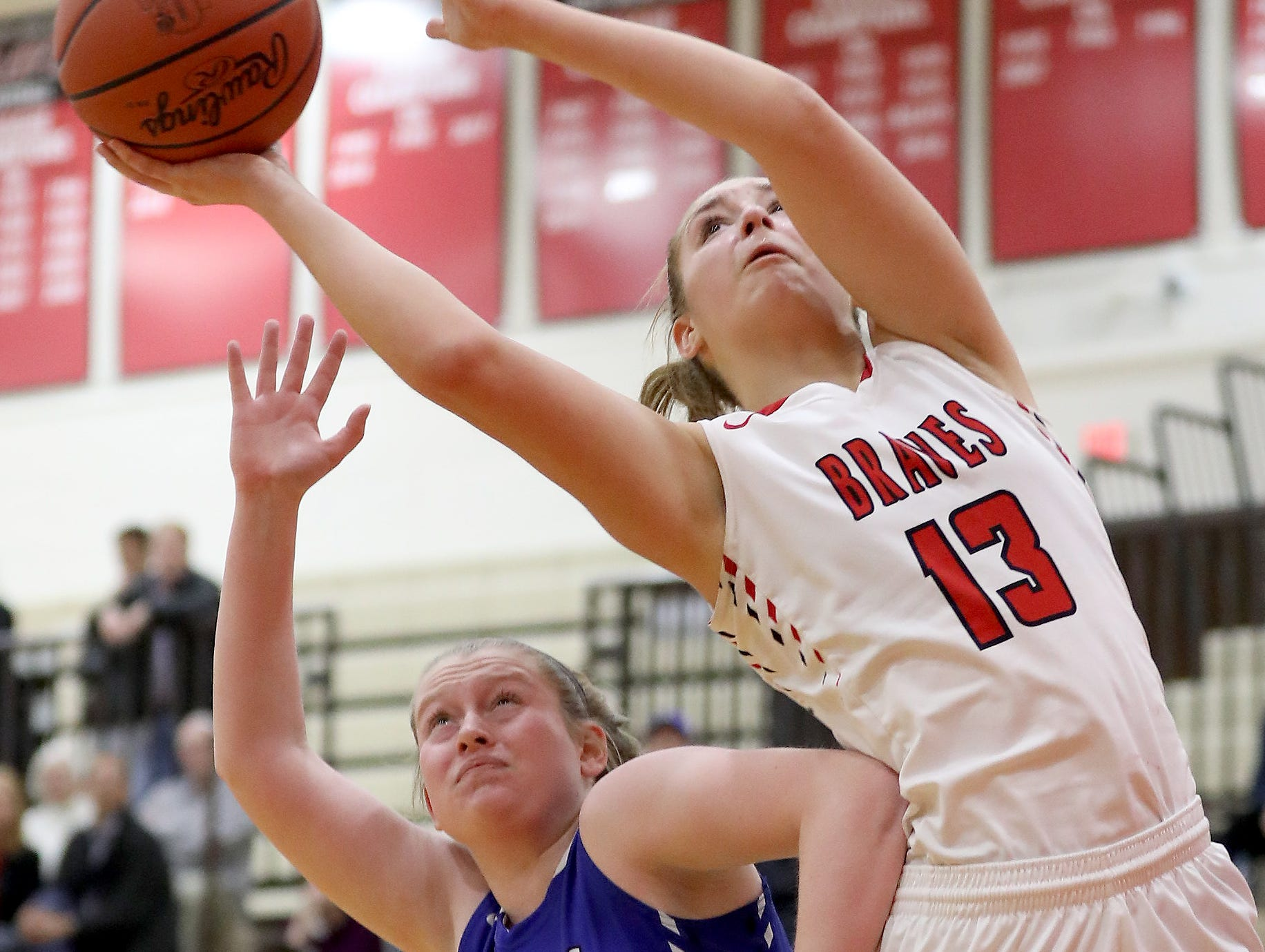 Indian Hill guard Maddie  Antenucci (13) shoots over Wyoming guard Lauren Rutherford (22) during their basketball game Thursday, Jan.10, 2019.