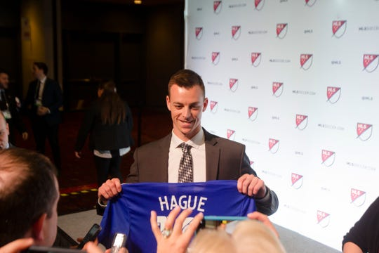 Jimmy Hague holds up his jersey for a photograph after being drafted by FC Cincinnati as the second round of the MLS Superdraft on Friday, Jan. 11, 2019 in Chicago, Illinois.