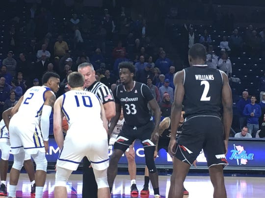 UC's Nysier Brooks takes the opening tip for the Bearcats at Tulsa