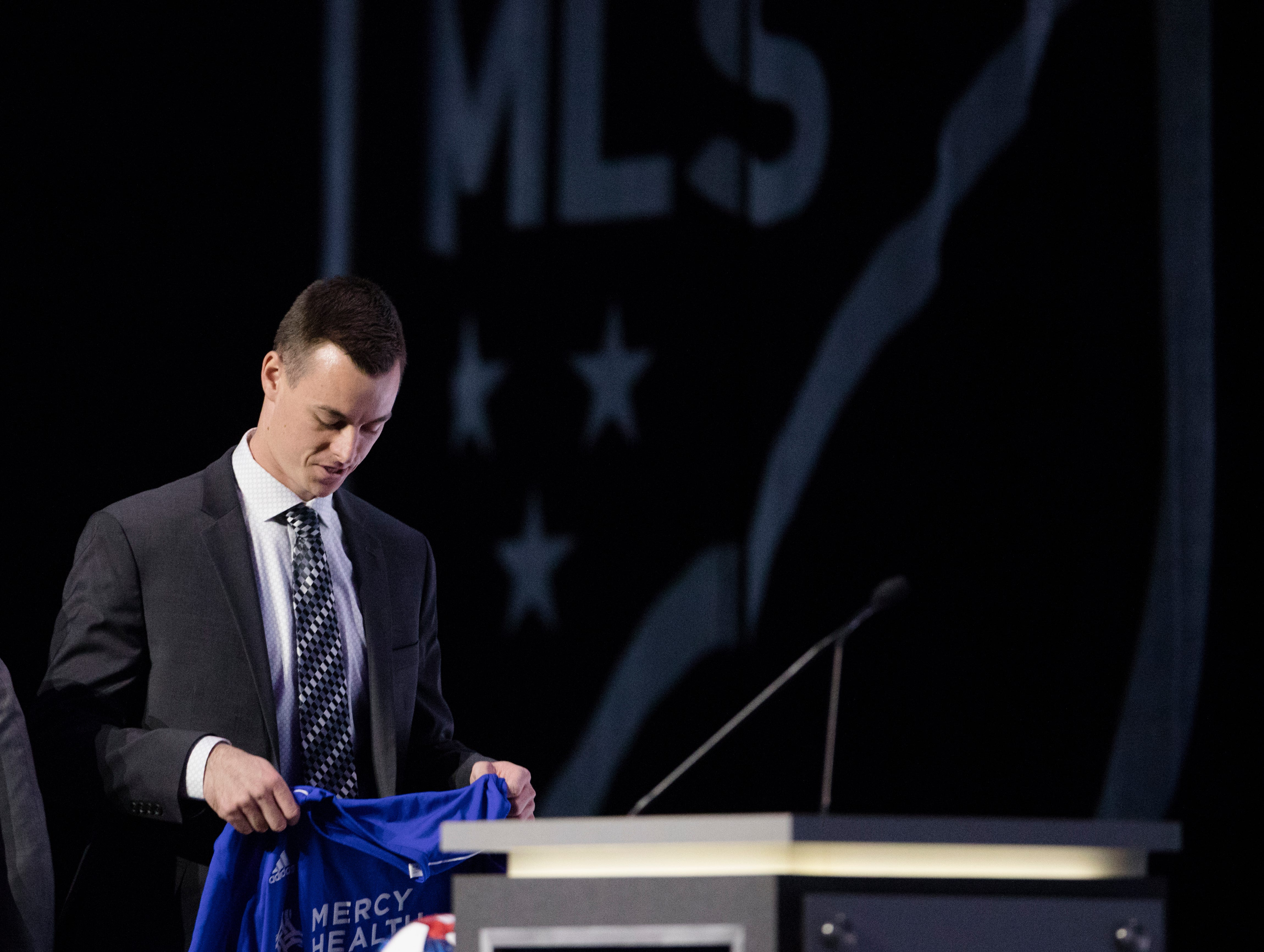 Jimmy Hague walks to the podium after being drafted by FC Cincinnati as the second round of the MLS Superdraft on Friday, Jan. 11, 2019 in Chicago, Illinois.