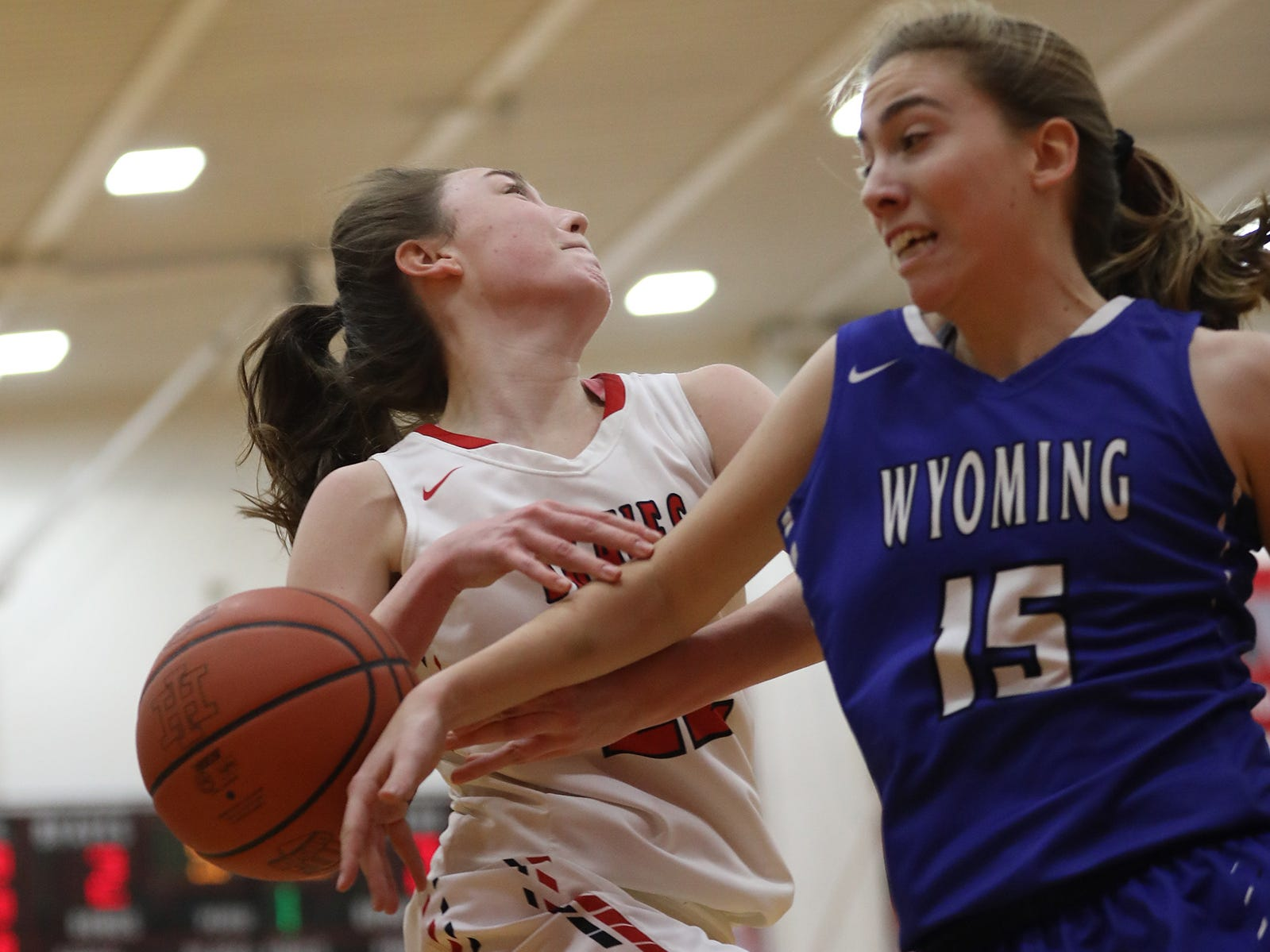 Wyoming guard Elly McCullumsmith (15) knocks the ball away from Indian Hill guard Ella Riggs during their basketball game, Thursday, Jan. 10,2015.