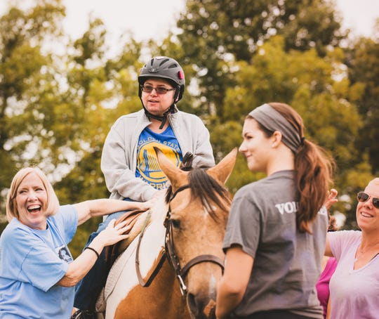 Adaptive Riding Lesson at Mane Stream. (Left to right) Debi Delorenzo of Somerville, Andy Chipparullo of Bernardsville and Gillian Kramlick of Neshanic Station, and PATH Intl. Certified Instructor, Kelly Champion of Washington.