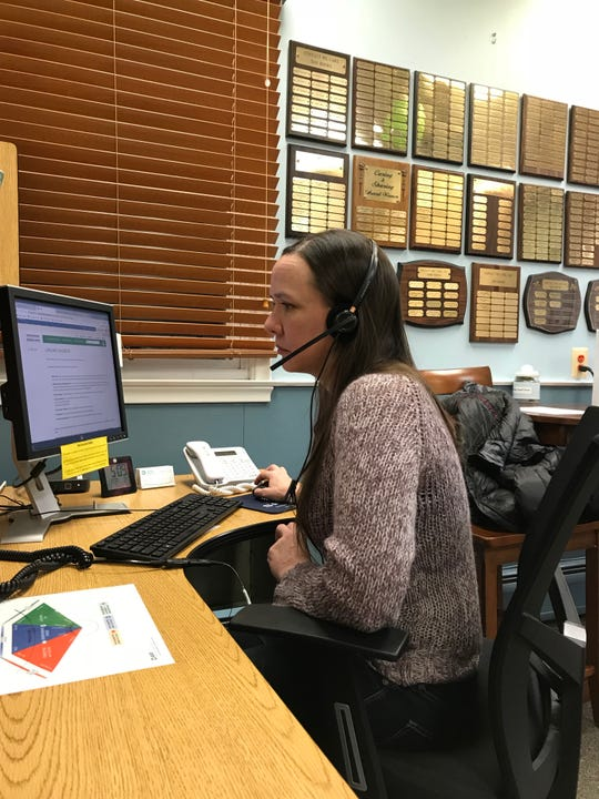 Sharon Grau talking to a caller at a Caring Contact call center. Grau has been a volunteer listener for more than 12 years. Many of the calls the New Brunswick native speaks with have recently lost a loved one, a job or all hope. Sometimes, all three.