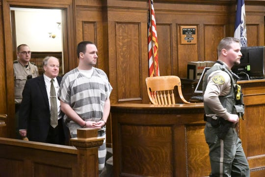 Curtis Van Dam is led into the courtroom of the Sioux County Courthouse in Orange City on Friday, Jan. 11, 2019. The former Sioux Center Christian School teacher was sentenced to 60 years in a state prison for improper sexual contact with children.