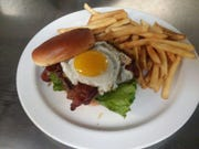 The Five Star Burger at Five19 with a fried egg, green chilies, pepper jack cheese and bacon.