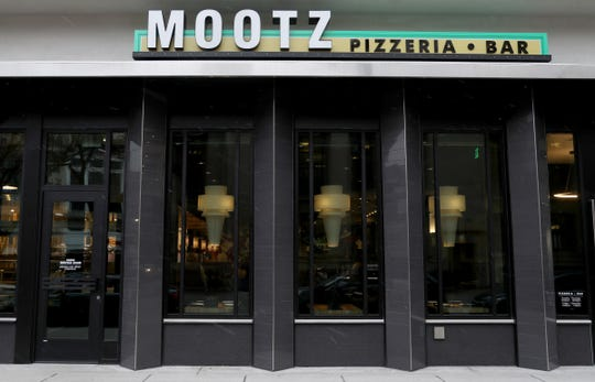 The exterior of Mootz Pizzeria and Bar in downtown Detroit on Wednesday, January 9, 2019. The new restaurant that serves a variety of classic Italian food and large pizza slices is set to open on January, 28, 2019.