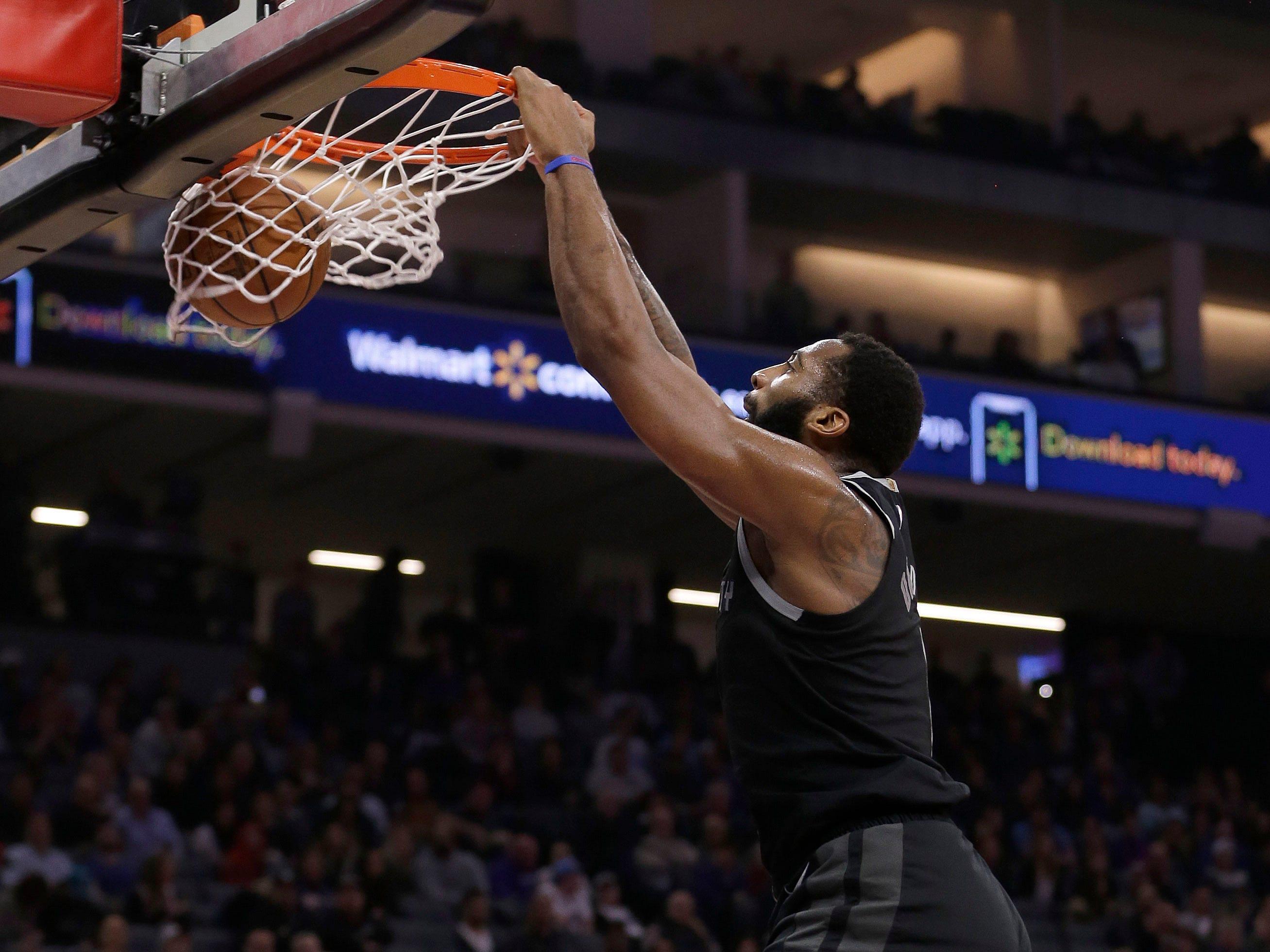 Detroit Pistons center Andre Drummond dunks as Sacramento Kings guard Bogdan Bogdanovic, right, watches during the first quarter of an NBA basketball game Thursday, Jan. 10, 2019, in Sacramento, Calif.