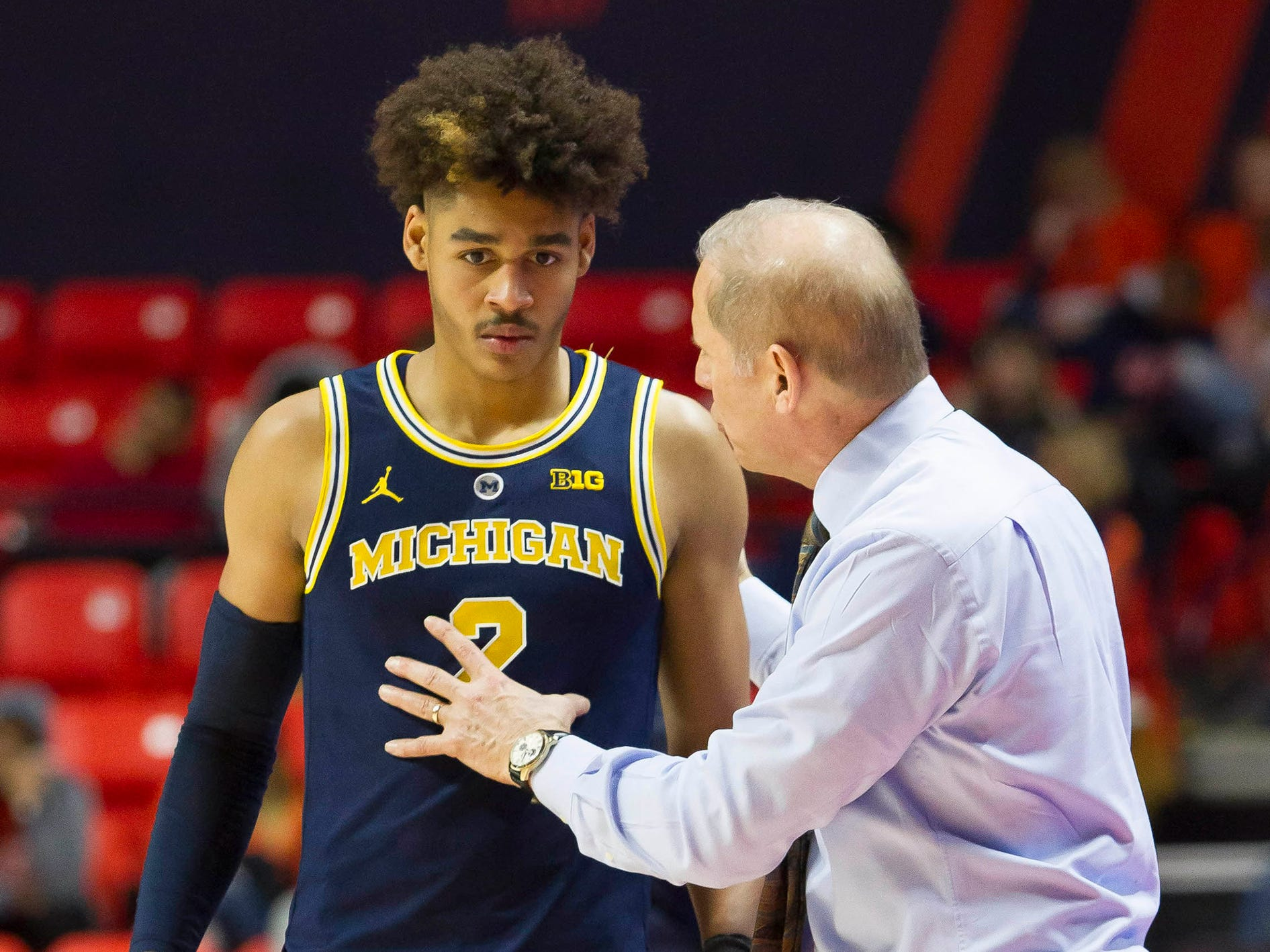 Michigan coach John Beilein has a discussion with guard Jordan Poole during the second half of U-M's 79-69 win on Thursday, Jan. 10, 2019, in Champaign, Ill.