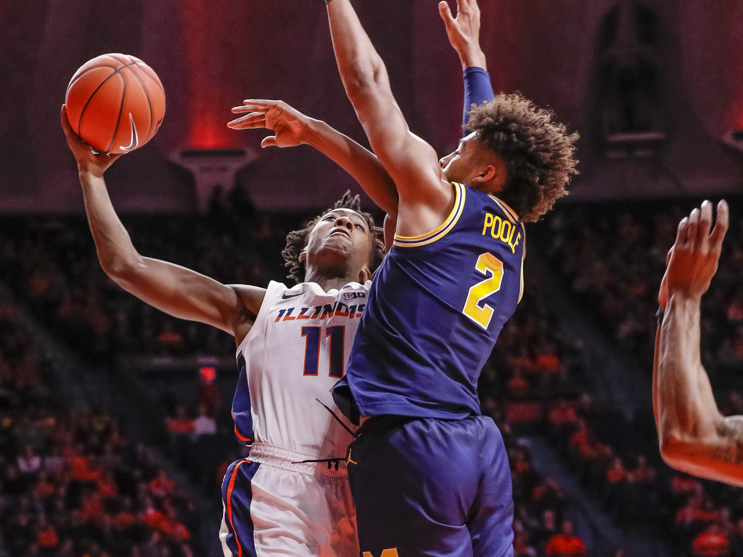 1080501130.jpg CHAMPAIGN, IL - JANUARY 10: 2Ayo Dosunmu #11 of the Illinois Fighting Illini shoots the ball against Jordan Poole #2 of the Michigan Wolverines during the first half action at State Farm Center on January 10, 2019 in Champaign, Illinois.
