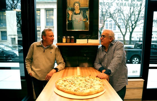 (L to R) Operating partners of Mootz Pizzeria and Bar in downtown Detroit, Dean Walters and Tony Sacco inside their new restaurant, Mootz Pizzeria and Bar on Wednesday, January 9, 2019.  The restaurant near the Skillman library and the Z Garage serves a variety of classic Italian food and large pizza slices is set to open on January, 28, 2019.