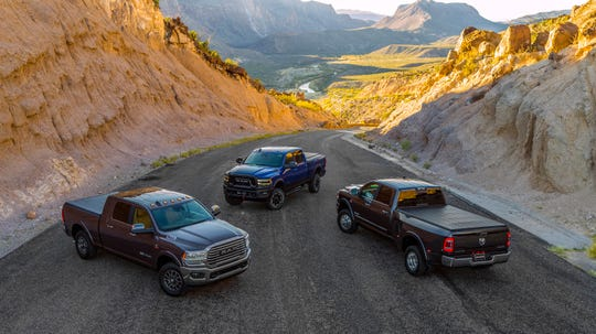 The lineup for the 2019 Ram Heavy Duty  trucks includes the 2500 Heavy Duty Longhorn Mega Cab, left, Power Wagon, center, and 3500 Heavy Duty Limited Crew Cab Dually.