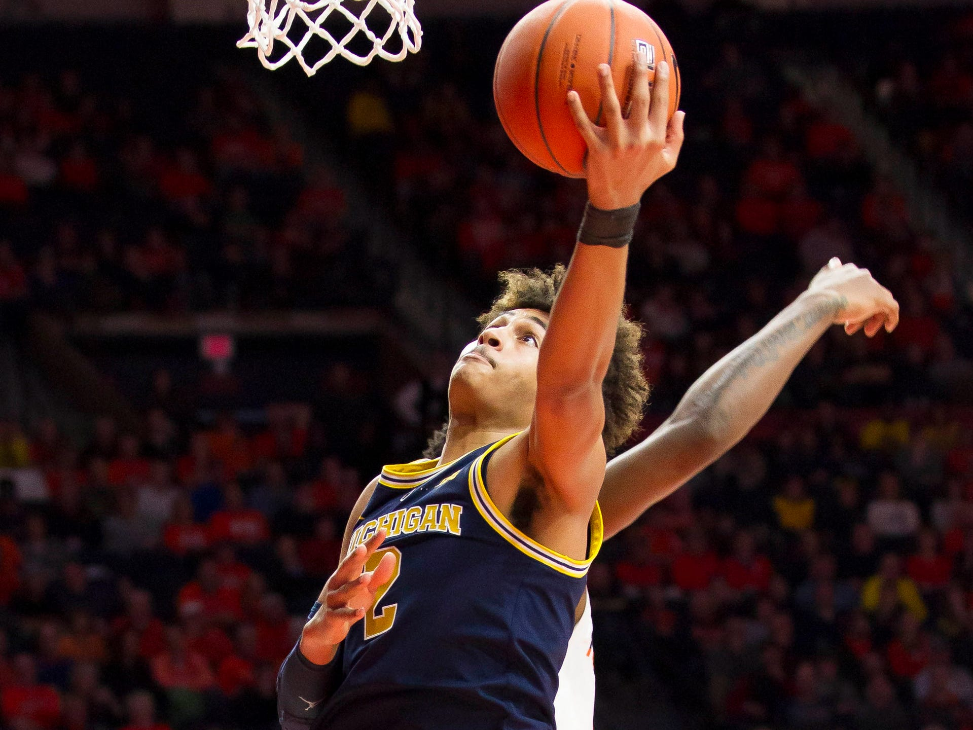 Michigan guard Jordan Poole shoots defended by Illinois guard Ayo Dosunmu during the second half of U-M's 79-69 win on Thursday, Jan. 10, 2019, in Champaign, Ill.