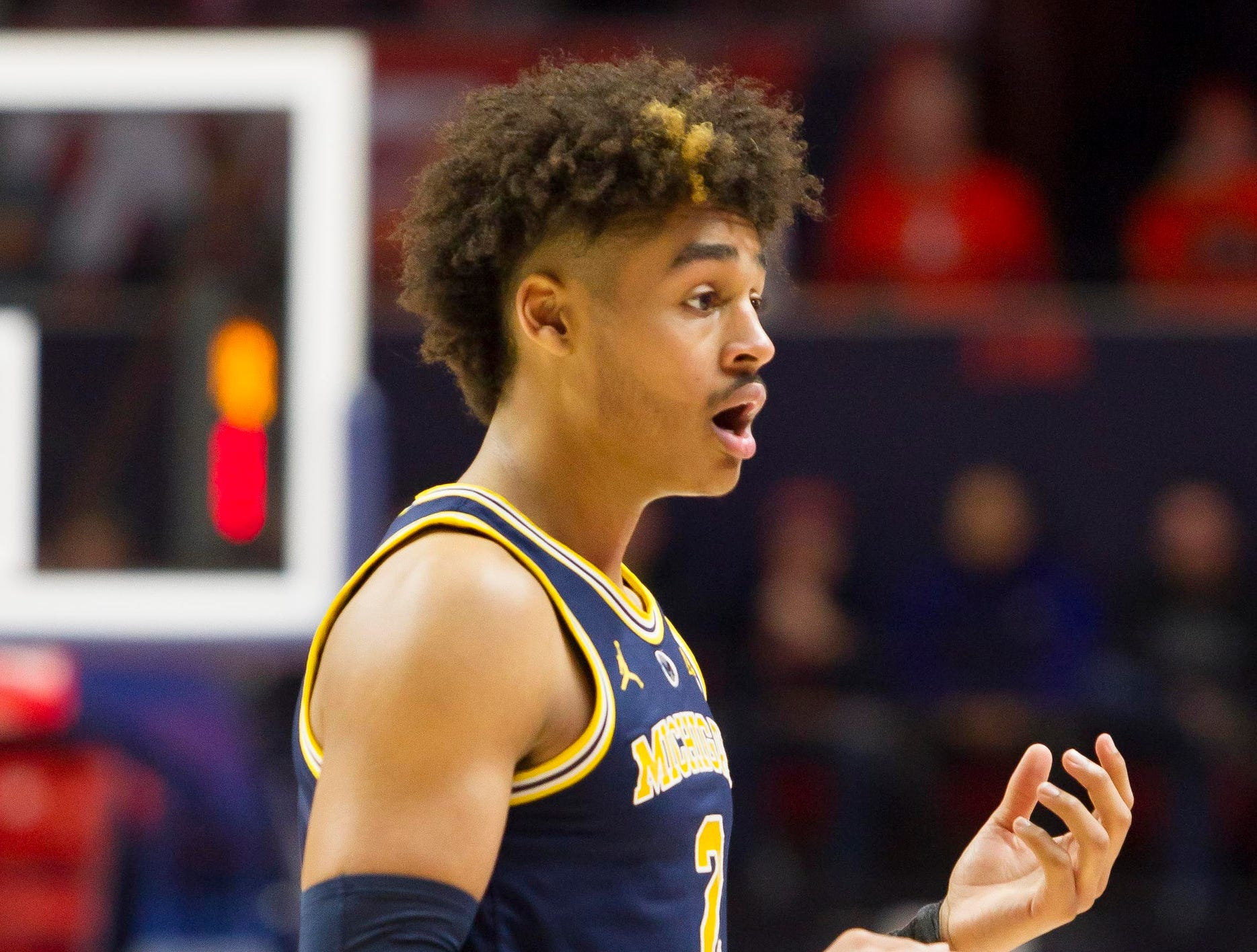 Michigan Wolverines guard Jordan Poole (2) reacts to a foul during the first half against the Illinois Fighting Illini  at State Farm Center on January 10, 2019 in Champaign, Illinois.
