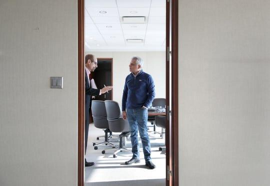 Kumar Galhotra, president of Ford North America, right, talks with Said Deep, head of North America communications, in Galhotra's office at Ford World Headquarters in Dearborn.