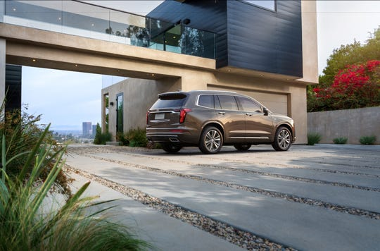 "The new Cadillac XT6 is described as the Escalade's ""little brother."""