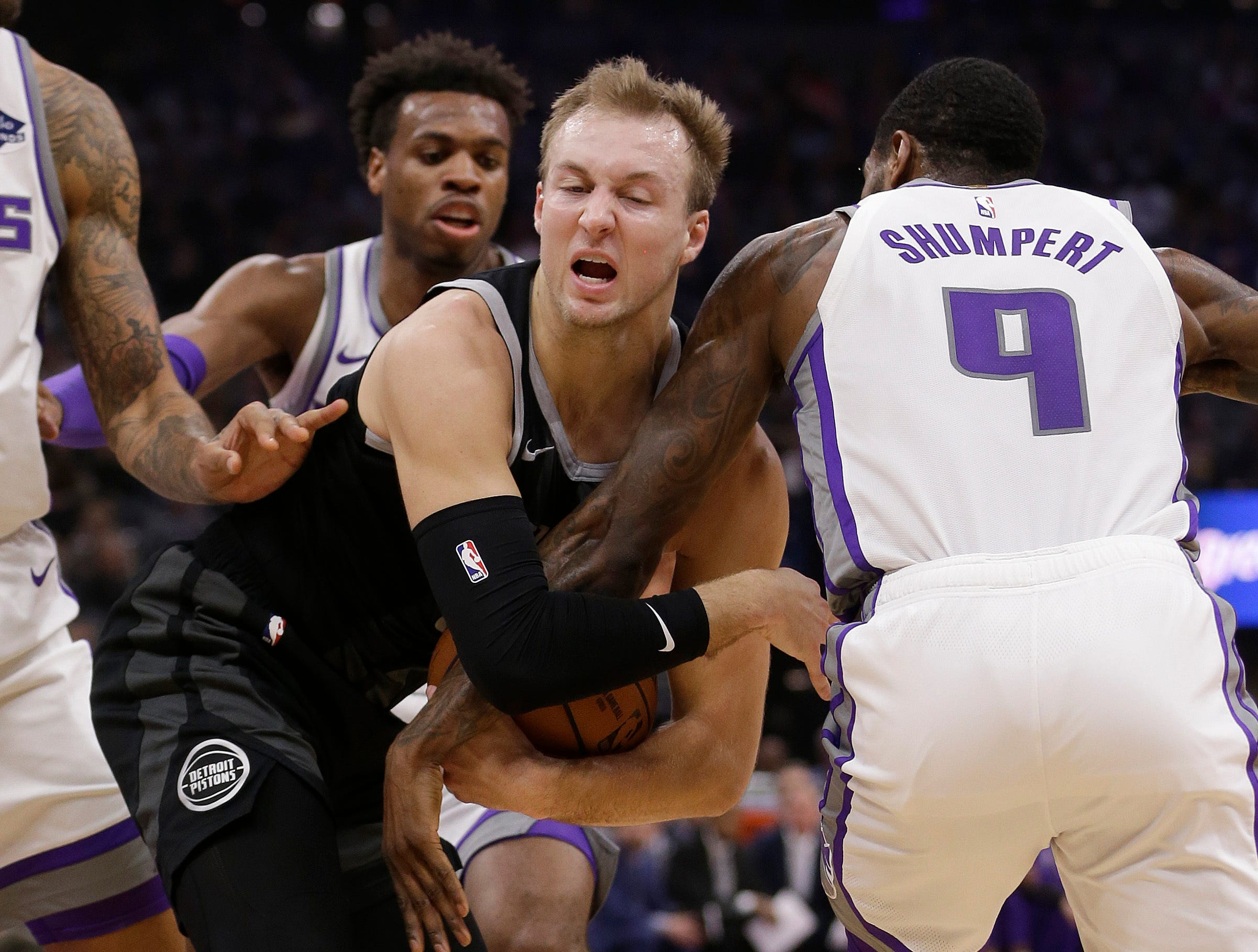 Detroit Pistons guard Luke Kennard, front left, tries to keep the ball from Sacramento Kings guard Iman Shumpert, right, during the first quarter of an NBA basketball game Thursday, Jan. 10, 2019, in Sacramento, Calif.