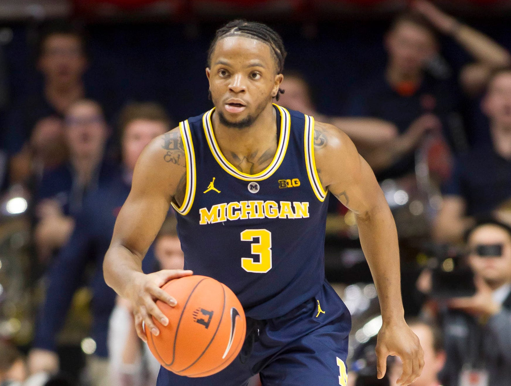 Michigan guard Zavier Simpson brings the ball up the court during the second half of U-M's 79-69 win on Thursday, Jan. 10, 2019, in Champaign, Ill.