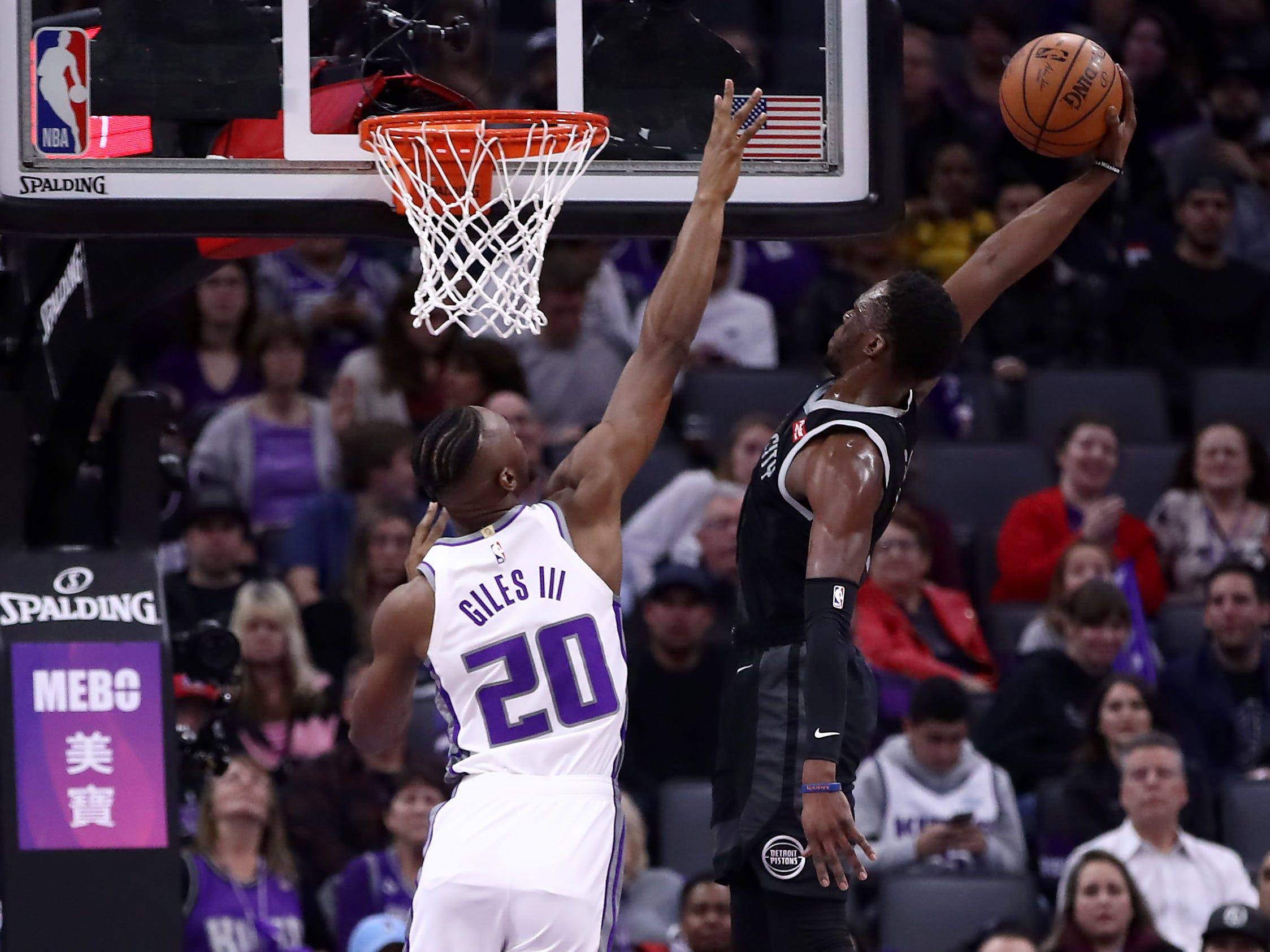 Reggie Jackson #1 of the Detroit Pistons dunks the ball on Harry Giles #20 of the Sacramento Kings at Golden 1 Center on January 10, 2019 in Sacramento, California.