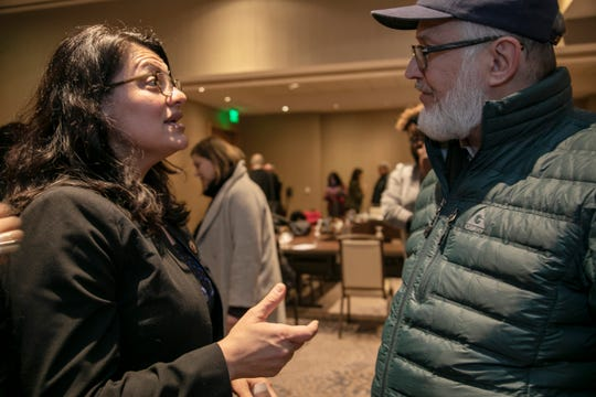 Michigan Congresswoman Rashida Tlaib, left, speaks to Mark Coryell of Ann Arbor who represents EPA employees that regulate the petroleum and auto industry. Coryell spoke about his members not working during a press conference Friday Jan. 11, 2019 at the Westin Hotel at the Detroit Metropolitan Wayne County Airport.