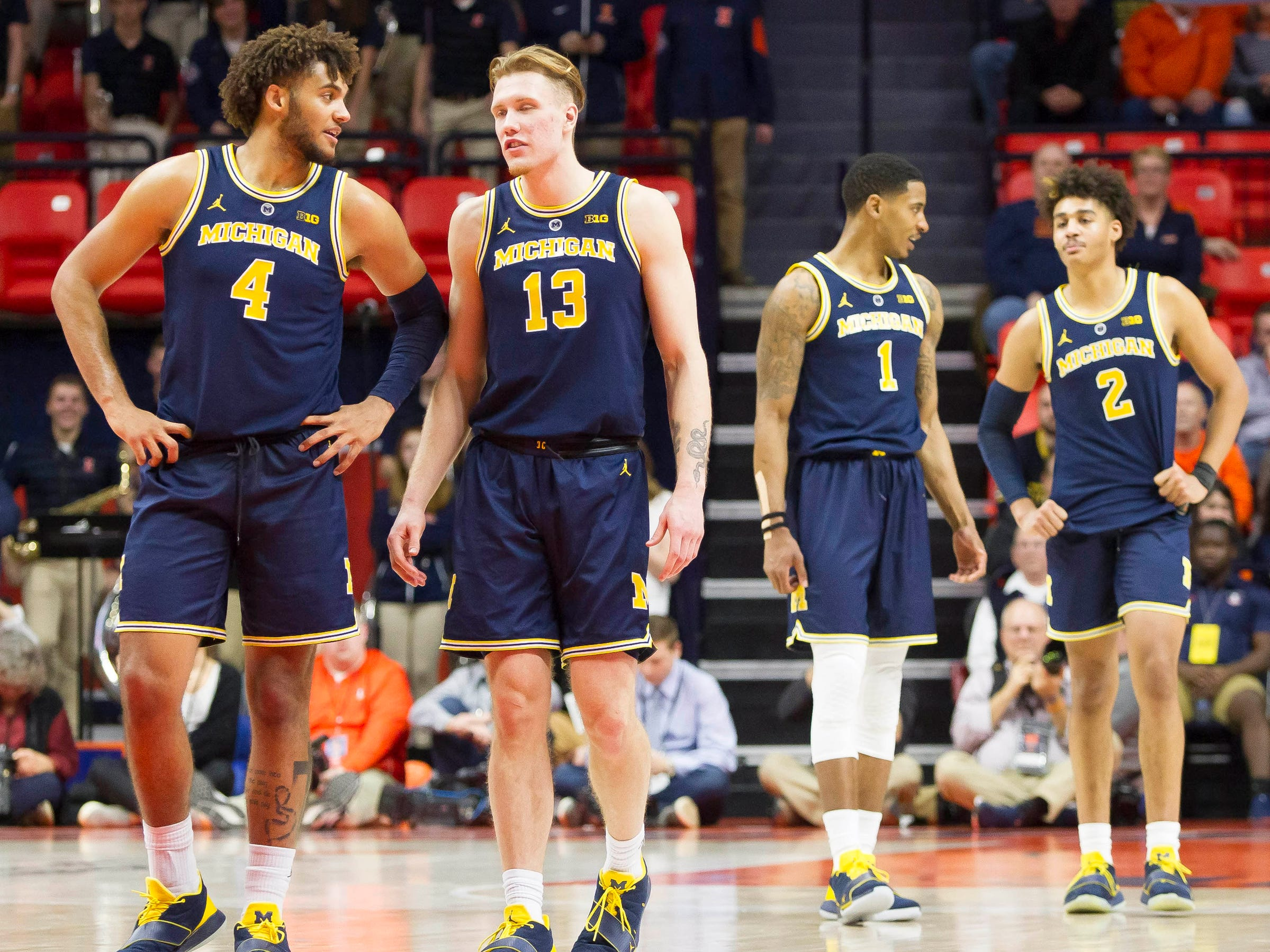 (From left) Michigan forwards Isaiah Livers and Ignas Brazdeikis and guards Charles Matthews and Jordan Poole take the court following a timeout  during the second half of U-M's 79-69 win on Thursday, Jan. 10, 2019, in Champaign, Ill.