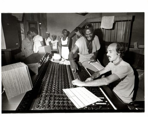 Above: George (Fr. Funkestein) Clinton, a producer at United Sound Studios, works with engineer Jim Vitti at the mixer. Below: Ex-Motown employees Michael Grace (Center) and John Lewis (right) opened Detroit's newest big recording studio, Sound Suite, and employ such prestigious produces as Michael Stokes.