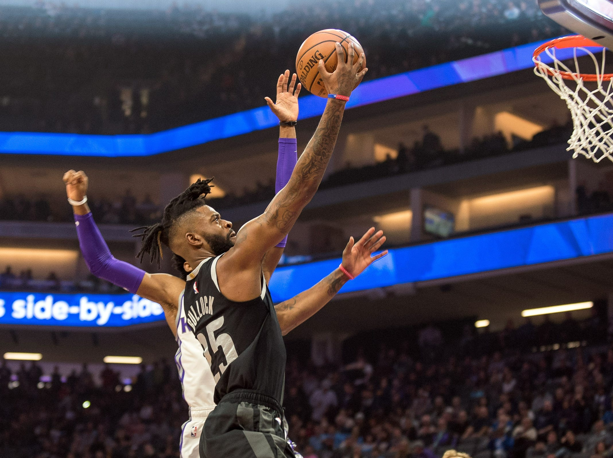 Detroit Pistons guard Reggie Bullock (25) goes up for the shot against the Sacramento Kings during the first quarter at Golden 1 Center on Thursday, Jan. 10, 2019, in Sacramento, Calif.