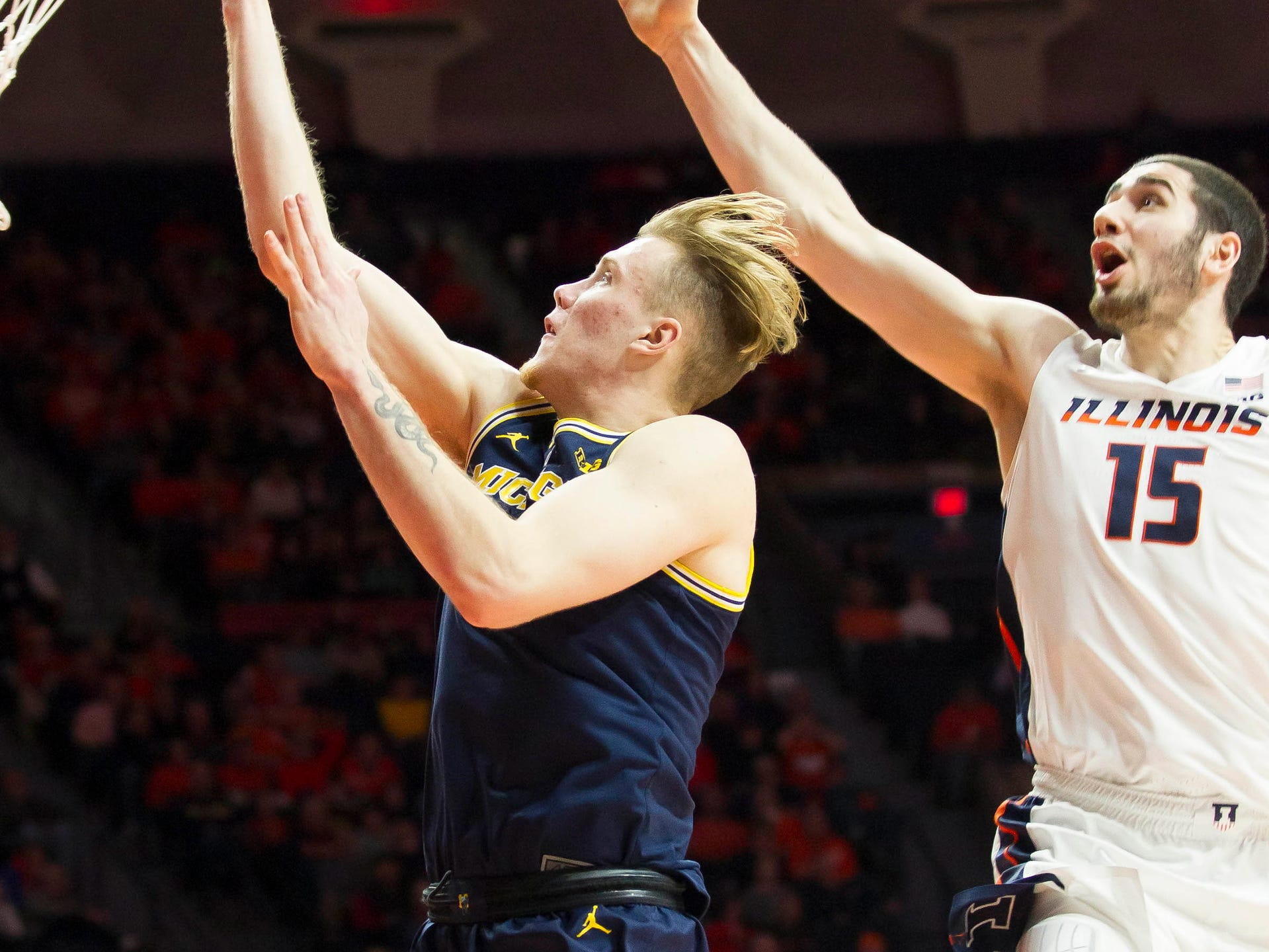 Michigan forward Ignas Brazdeikis shoots defended by Illinois forward Giorgi Bezhanishvili during the second half of U-M's 79-69 win on Thursday, Jan. 10, 2019, in Champaign, Ill.