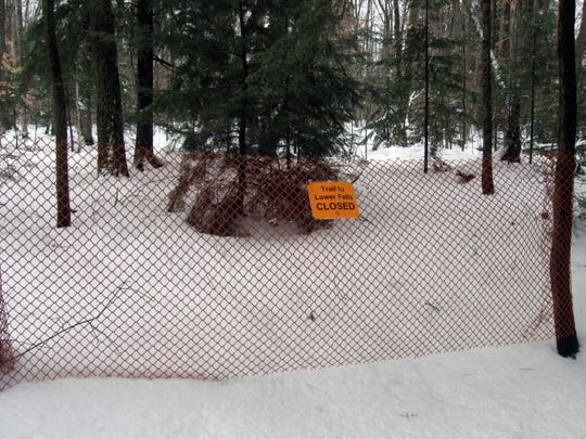 Icy conditions have shut the River Trail at Tahquamenon Falls State Park in Michigan's Upper Peninsula.