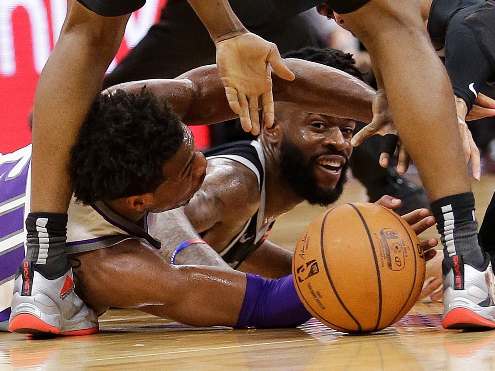 Kings guard Buddy Hield, left, and Pistons guard Reggie Bullock go for the ball during the second half of the 112-102 loss to the Kings on Thursday, Jan. 10, 2019, in Sacramento.
