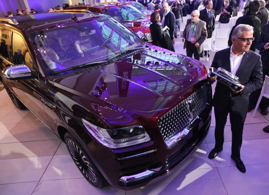 Kumar Galhotra, group vice president, Lincoln and chief marketing officer for Ford Motor Company, holds the Truck of the Year award after the Lincoln Navigator was tabbed the winner during the North American International Auto Show on Monday, Jan. 15, 2018, in Detroit.
