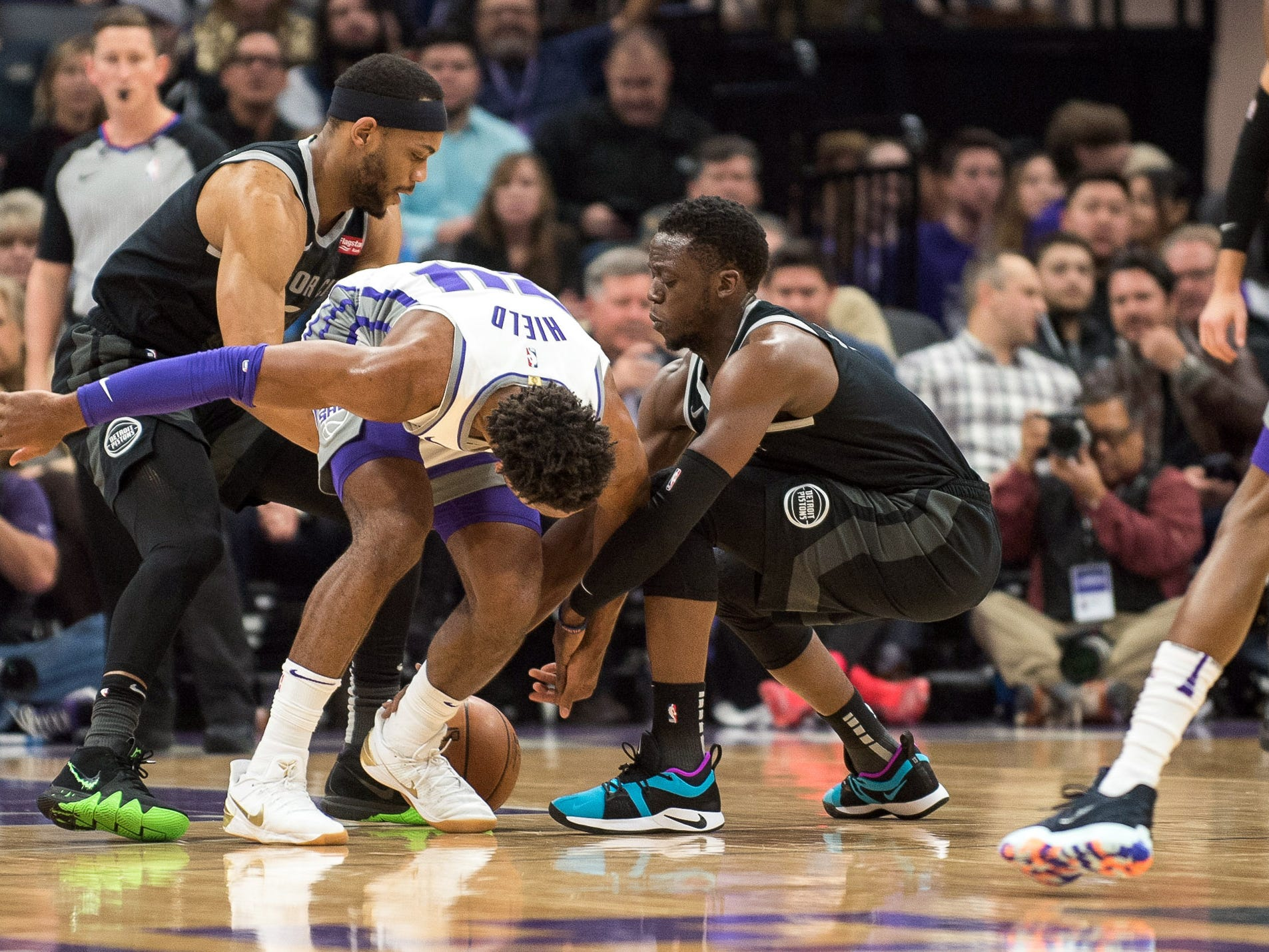 Detroit Pistons guard Bruce Brown (6) and guard Reggie Jackson (1) fight for possession of the ball with Sacramento Kings guard Buddy Hield (24) during the first quarter at Golden 1 Center on Thursday, Jan. 10, 2019, in Sacramento, Calif.