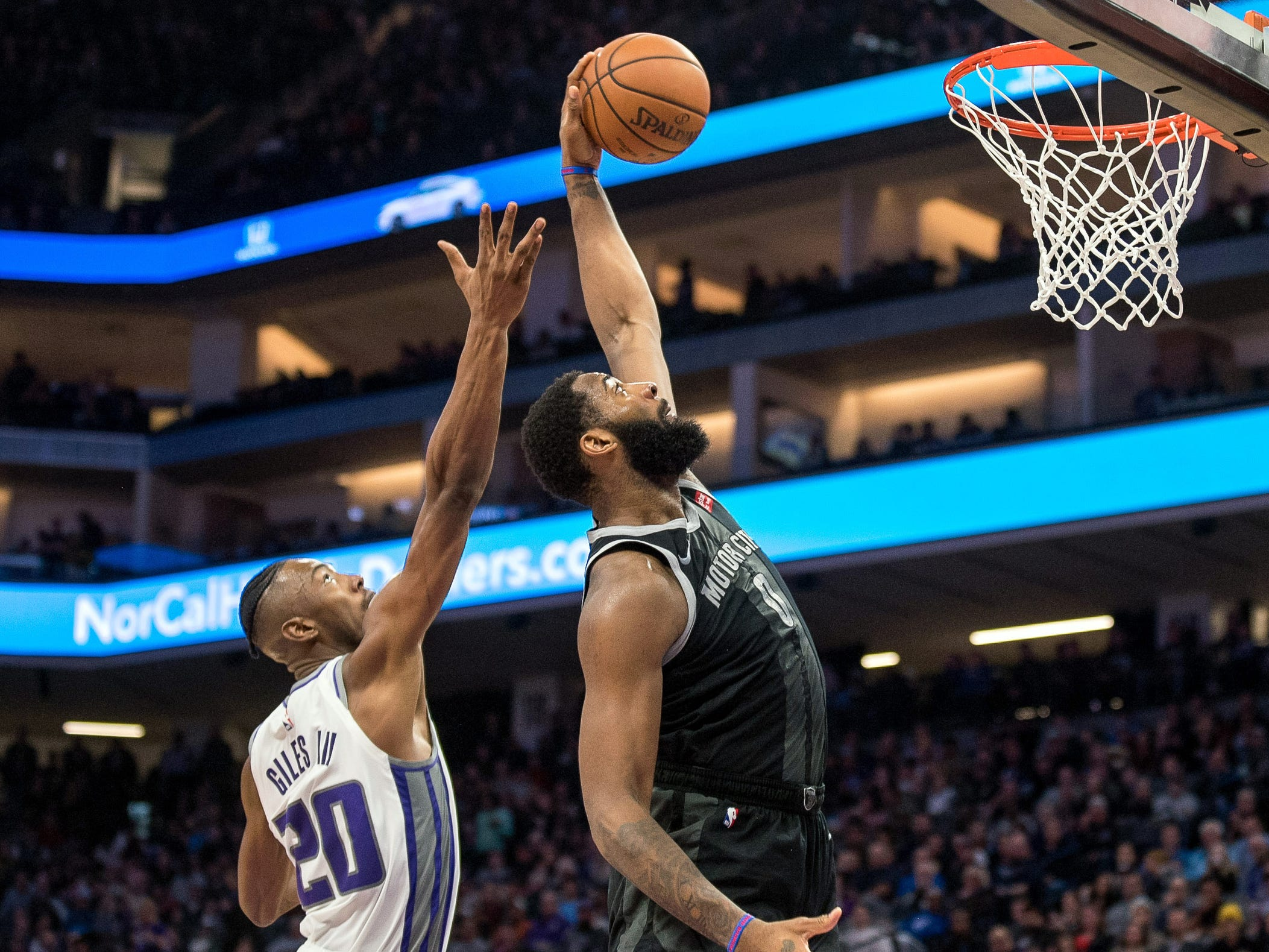 Pistons center Andre Drummond grabs a rebound over Kings forward Harry Giles during the fourth quarter of the 112-102 loss to the Kings on Thursday, Jan. 10, 2019, in Sacramento.